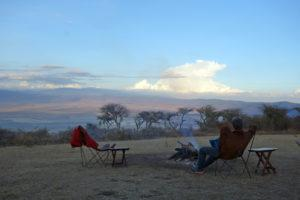 A man sitting in a chair overlooking the Ngorongoro Crater in Tanzania