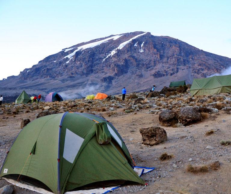 Views of Kibo peak Kilimanjaro at a campsite with multiple tents