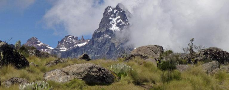 The peaks of Mt Kenya partially covered in clouds