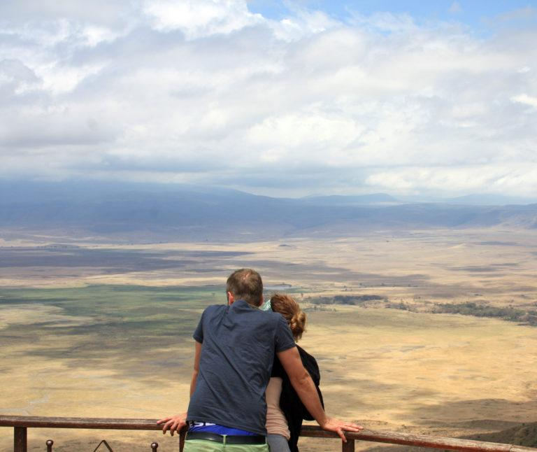 A couple looking across the Ngorongoro caldera from a view point