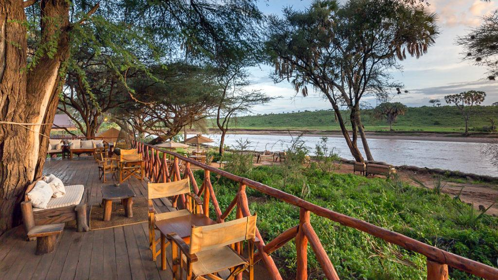 The deck of the Elephant Bedroom Camp with views of the Ewaso Nyiro River in Samburu National Reserve, Kenya