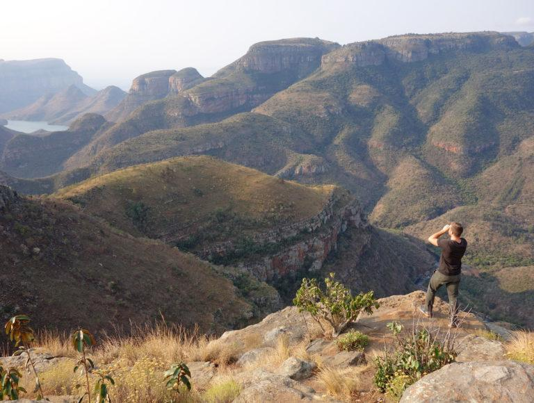 A hiker overlooking the Blyde River Canyon from a view point