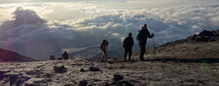 Climbers walking uphill on Kibo towards the Uhuru Peak, the highest point in Africa