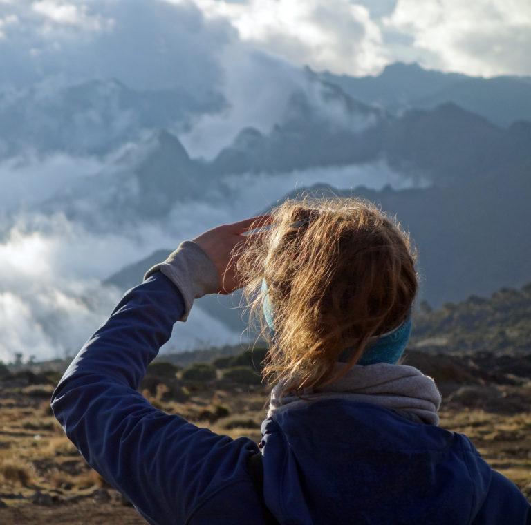 A hiker looking across the Shira Plateau on Machame Route, Kilimanjaro