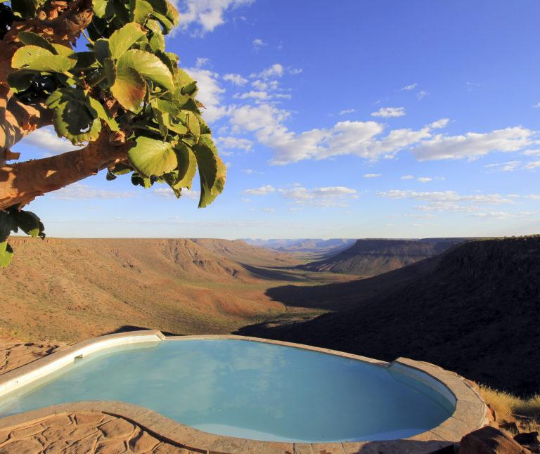 A swimming pool overlooking a valley in the Grootberg region in Namibia