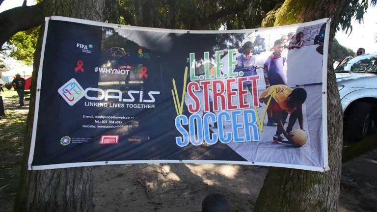 A sign for an upcoming football tournament at Oasis Place NGO in Cape Town